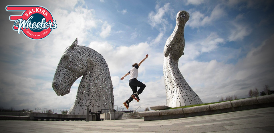 Photo of an impressive looking jump on skates from a wall in front of the Kelpies in Falkirk